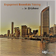 Photo of Brisbane skyline filtered orange with text saying Engagement Design Training in Brisbane and the IAP2 logo